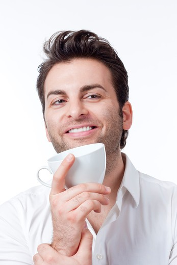 Stock Photo: 4286R-5851 man in shirt holding cup of coffee smiling - isolated on white
