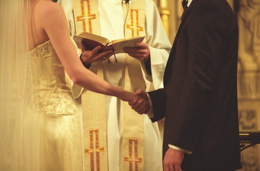 Stock Photo: 4286R-6174 Bridal couple in church exchanging vows