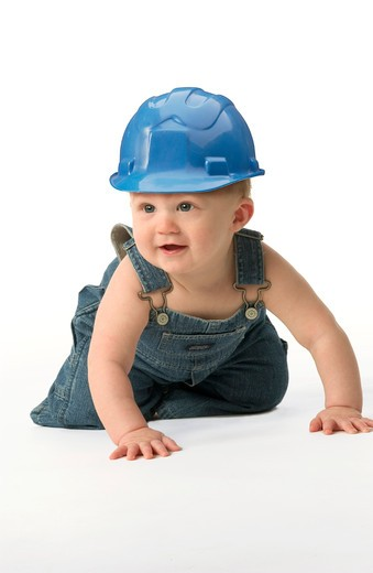 Stock Photo: 4286R-6656 A toddler wearing a blue hard hat.