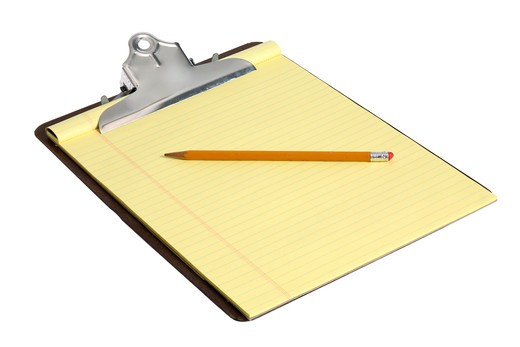 Stock Photo: 4286R-6863 Clipboard with notepad and pencil