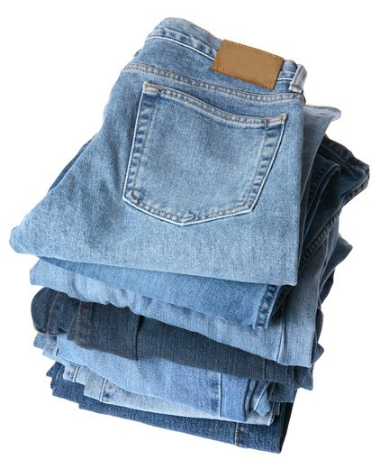 Stock Photo: 4286R-7524 Stack of denim jeans