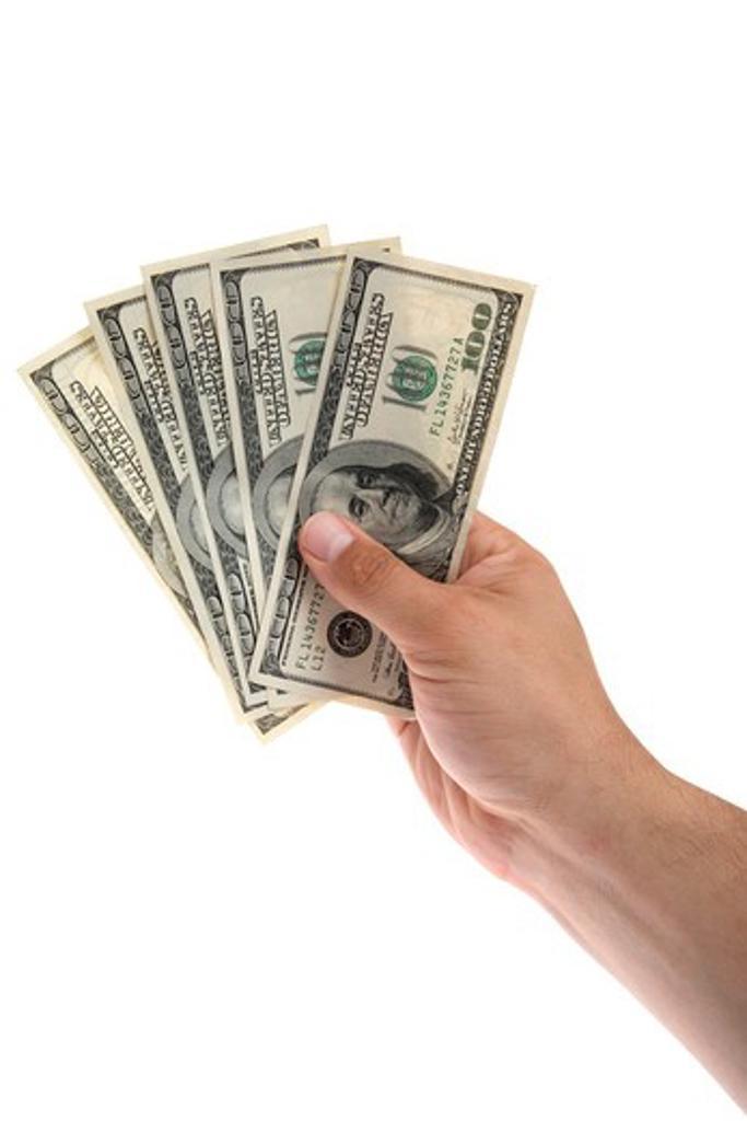 Hand holding money : Stock Photo