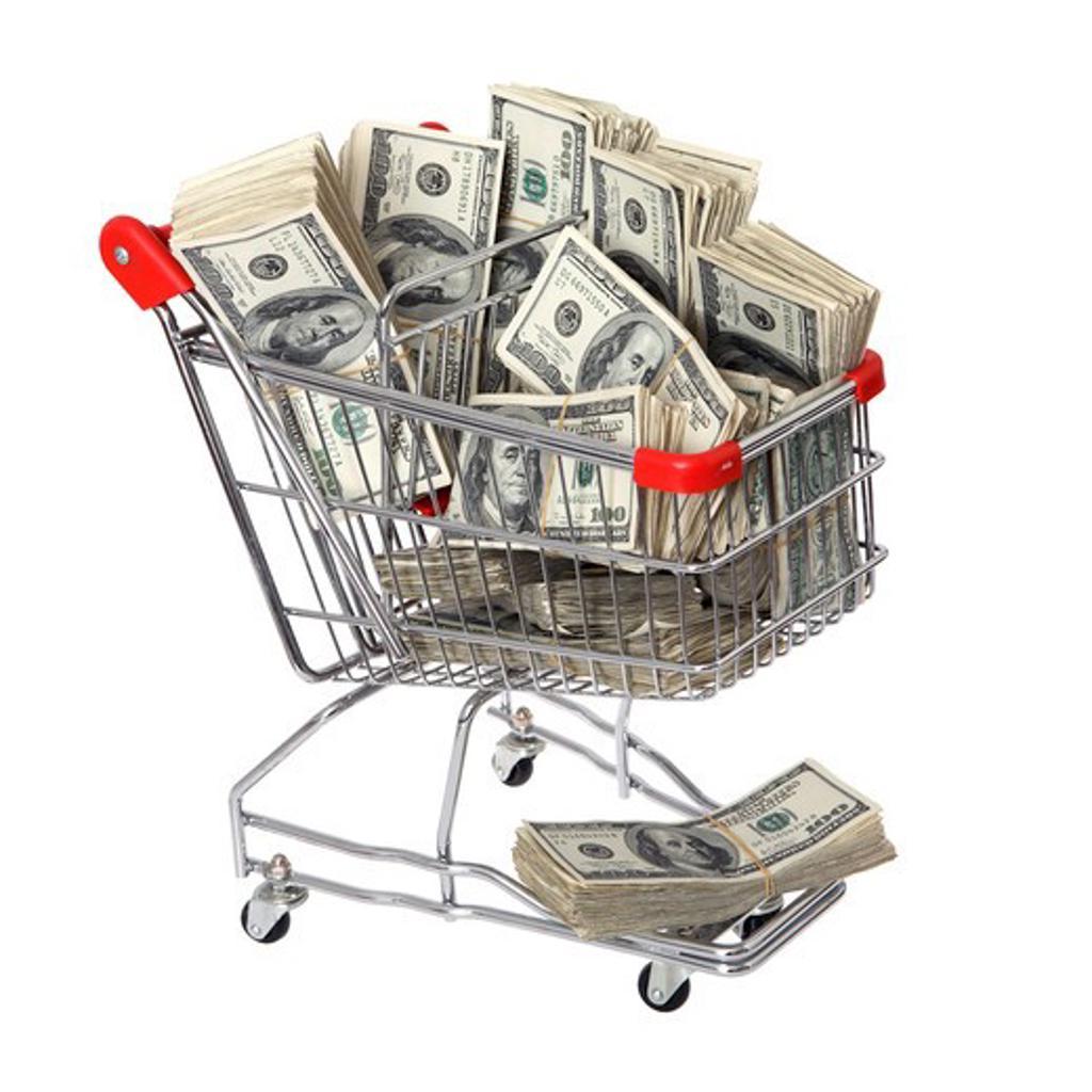 Shopping cart full of cash : Stock Photo