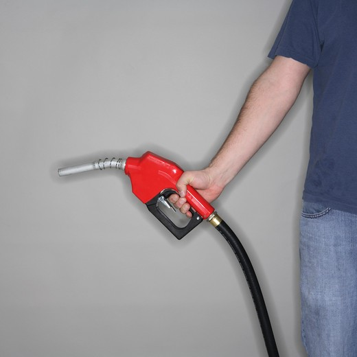 Man holding gas nozzle : Stock Photo