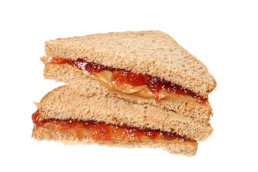 Peanutbutter and jelly sandwich, cutout on white background : Stock Photo