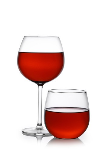 Stock Photo: 4286R-9201 Red wine in traditional and stemless glasses cutout, isolated on white background
