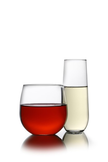 Stock Photo: 4286R-9202 Red and white wine in stemless glasses cutout, isolated on white background