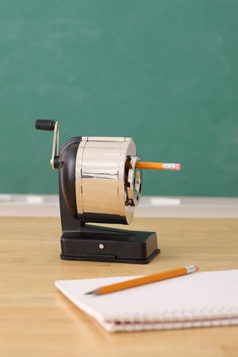 Stock Photo: 4286R-9246 School education still life of a pencil sharpener and notepad
