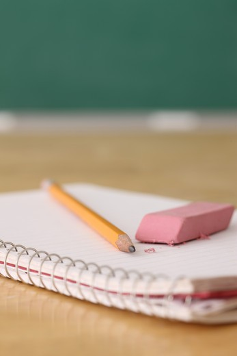 School education still life of pencil and eraser on notebook : Stock Photo