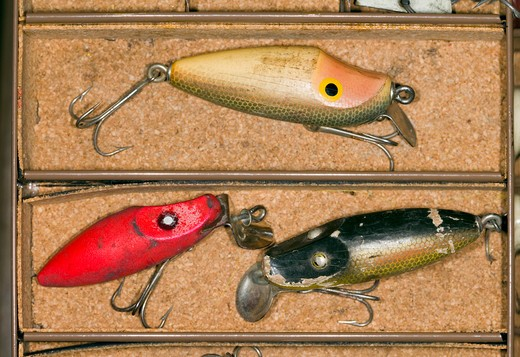 Stock Photo: 4286R-9451 Still life of vintage fishing lures in a tackle box.