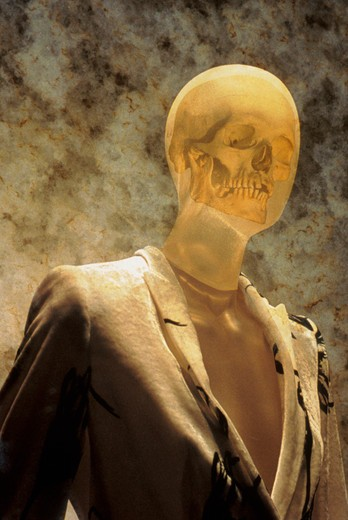 Computer generated image of a man whose face is transparent and his skull is visible. : Stock Photo