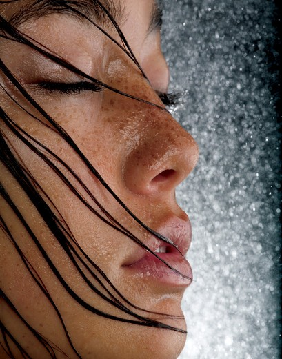 Stock Photo: 4288-1043 Freckled young woman with wet hair and closed eyes.