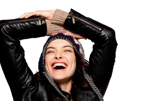 Happy brunette in black leather jacket and knit hat. : Stock Photo