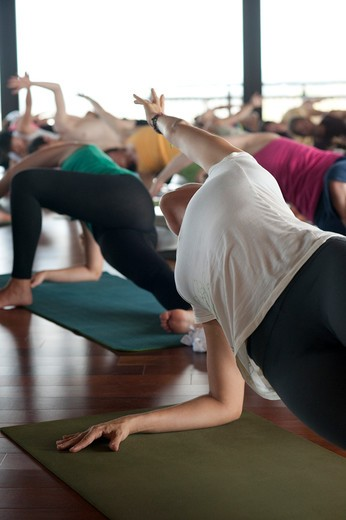 Stock Photo: 4288-1238 Yoga class on studio's wooden floor.