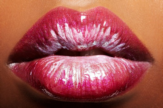 Stock Photo: 4288-1394 Macro shot of full lips covered with pink gloss, white metallic, and silvery pigments.