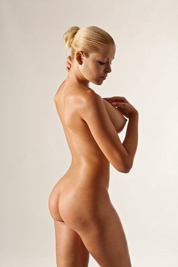 Side view of nude blonde Caucasian woman on a white background. : Stock Photo