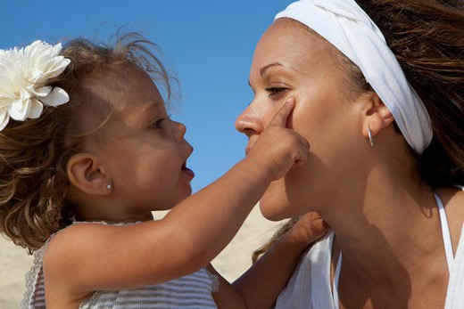Stock Photo: 4288-1462 Little girl touches woman's face.