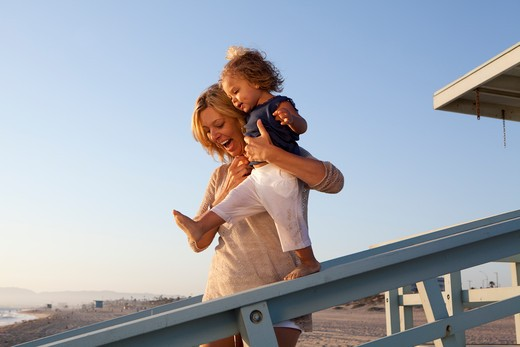 Stock Photo: 4288-1476 Smiling woman walks little girl down incline.