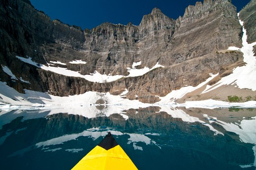 Stock Photo: 4288-1608 Kayak on Iceberg Lake, Glacier National Park.