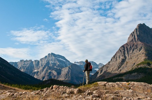 Stock Photo: 4288-1647 Woman hiking in Glacier National Park, Montana, USA.