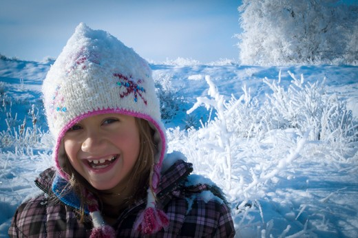 Stock Photo: 4288-1651 Smiling girl in snowy brush.