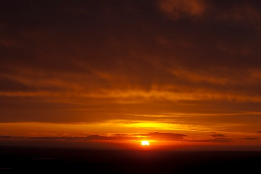 Stock Photo: 4288-1660 Sunrise peaking over horizon.