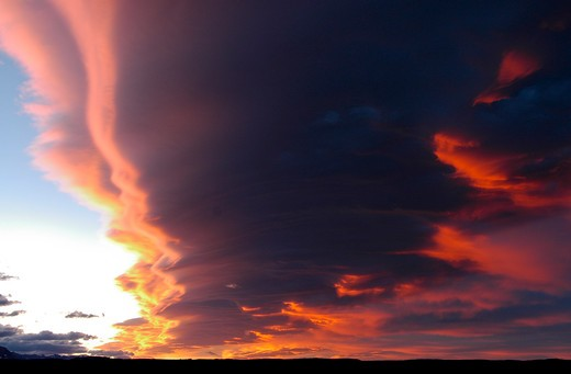 Stock Photo: 4288-1685 Clouds reflect red light of setting sun, Rocky Mountains, USA.