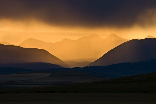 Stock Photo: 4288-1693 Mountains silhouetted by setting sun, Glacier National Park, USA.