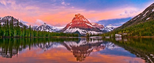 Reflection of spring sunrise, Two Medicine Lake, Sinopah Mountain, Glacier National Park : Stock Photo