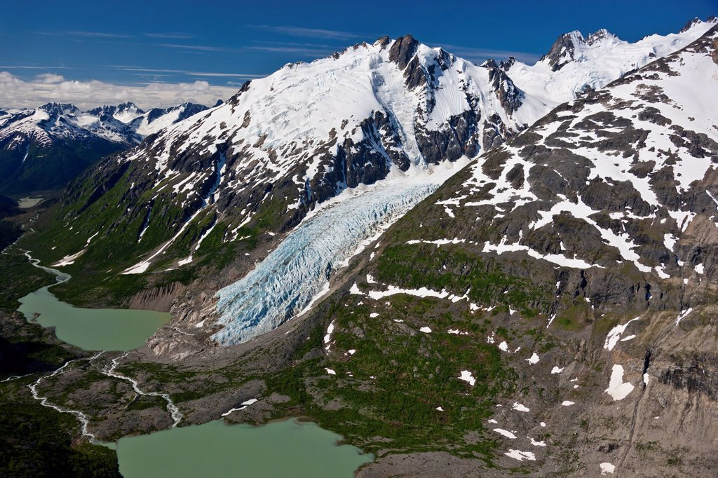 Aerial view of an unnamed glacier and headwaters of Nourse River in the Coastal Mountain Range north of Skagway, Southeast Alaska, Summmer : Stock Photo