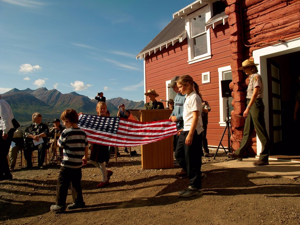 Stock Photo: 4289-10467 Flag raising at the Grand Opening ribbon cutting ceremony of the General Manager´s Office by the National Park Service, Kennicott Mine, Wrangell_St. Elias National Park & Preserve, Southcentral Alaska, Autumn
