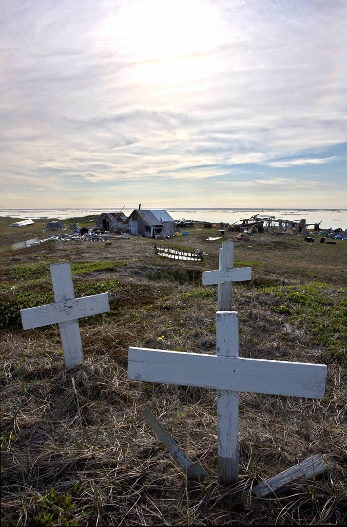 Stock Photo: 4289-10489 Grave markers on knoll above hunting camp on Shishmaref Island, Arctic Alaska, Summer