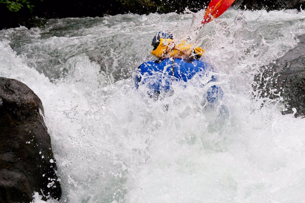 Man packrafting whitewater in lower Ship Creek near Anchorage, Southcentral Alaska, Summer : Stock Photo