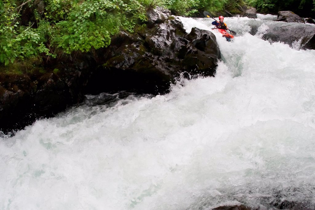 Stock Photo: 4289-11999 Man packrafting whitewater in a narrow canyon of lower Ship Creek near Anchorage, Southcentral Alaska, Summer