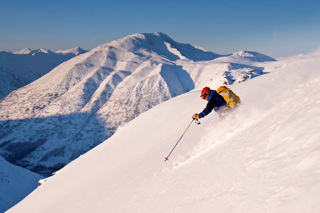 Stock Photo: 4289-12078 Man backcountry skiing powder on the south face of Cornbiscuit, Turnagain Pass, Kenai Mountains, Winter in Southcentral Alaska