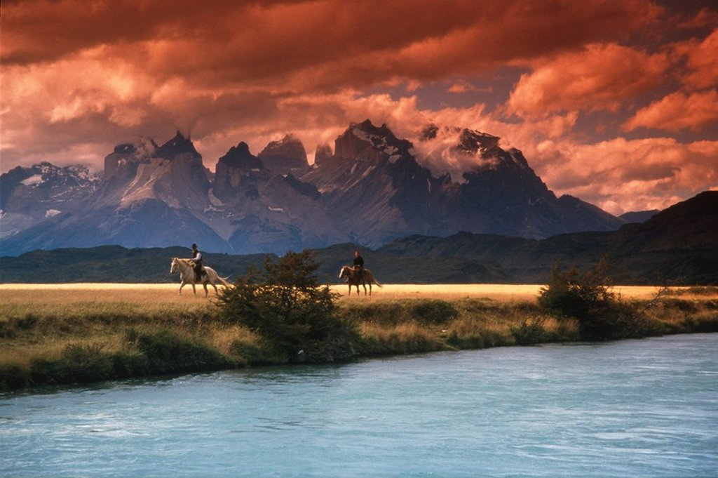 Stock Photo: 4289-12232 People horseback riding in Torres Del Paine National Park Patagonia Chile