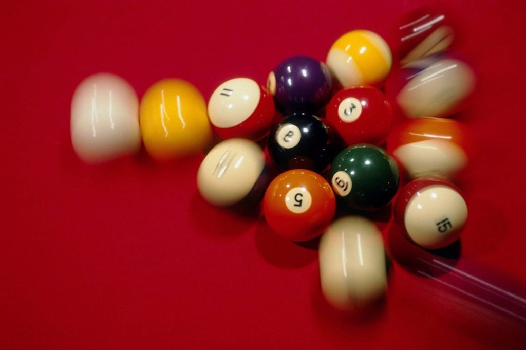 Stock Photo: 4289-12694 Closeup of Billiard Balls on red pool table blurred USA