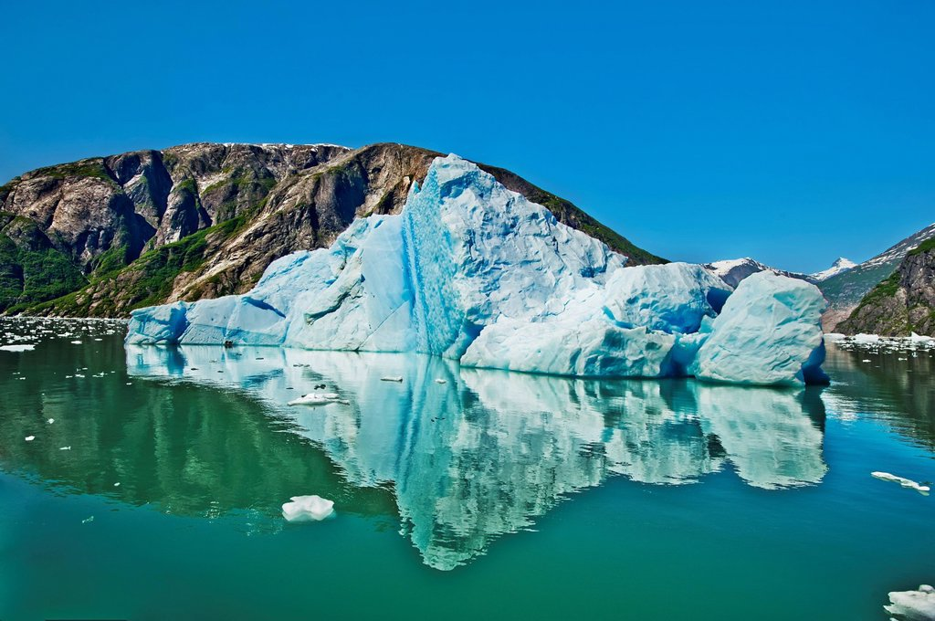 Large iceberg floats in Endicott Arm in Tracy Arm_Fords Terror Wilderness in Southeast Alaska, Summer : Stock Photo
