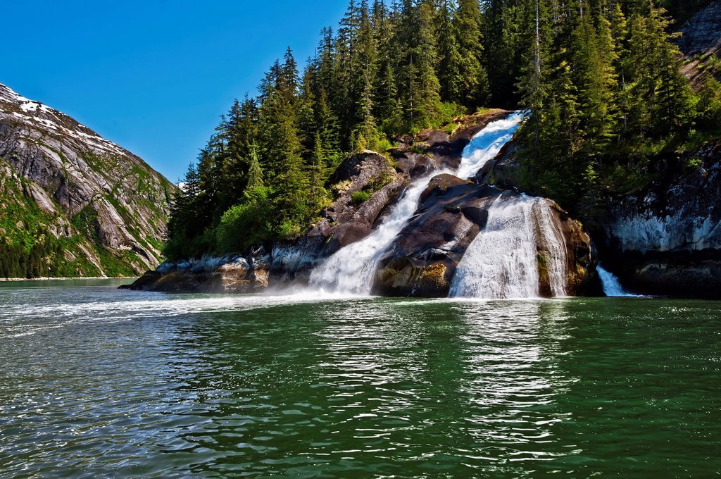 Icy Falls waterfall along the coast in Tracy Arm in Tracy Arm_Fords Terror Wilderness, Southeast Alaska, Summer : Stock Photo