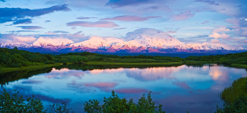 Panoramic view Mt. McKinley and Alaska Range reflecting in Reflection Pond during a midnight sunset, Denali National Park & Preserve, Interior Alaska, Summer : Stock Photo