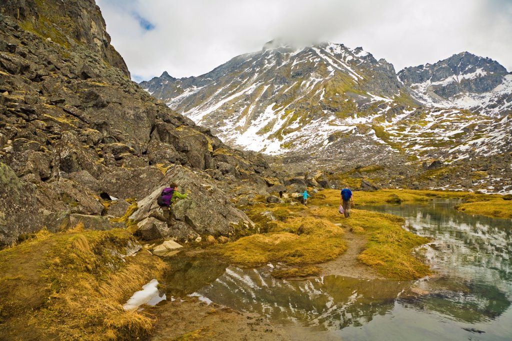 Stock Photo: 4289-13372 family hiking along Reed Lakes Trail, Talkeetna Mountains, Southcentral Alaska, Spring