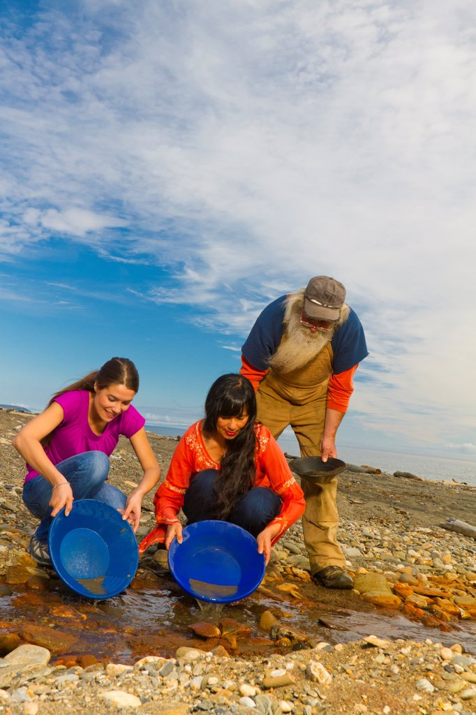Stock Photo: 4289-13427 Local prospector teaching visitors how t pan gold near Nome, Arctic Alaska, Summer