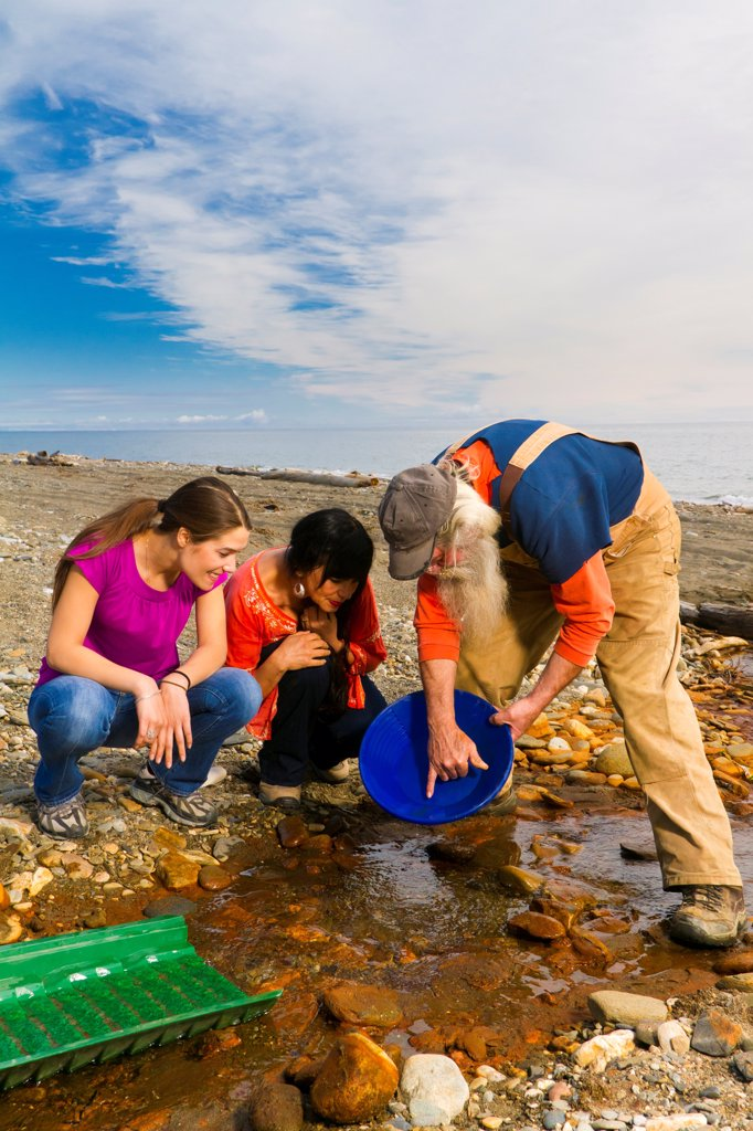 Stock Photo: 4289-13428 Local prospector teaching visitors how t pan gold near Nome, Arctic Alaska, Summer