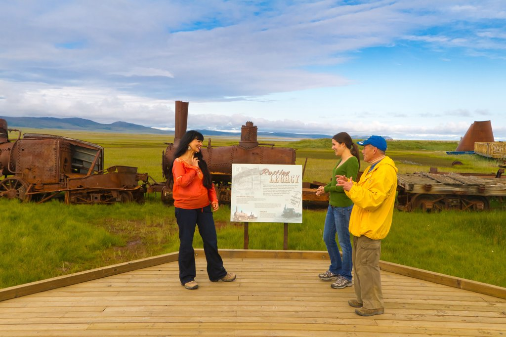 Tour guide gives a tour of the Last Train to Nowhere near Solomon, Nome_Council Road, Arctic Alaska, Summer : Stock Photo