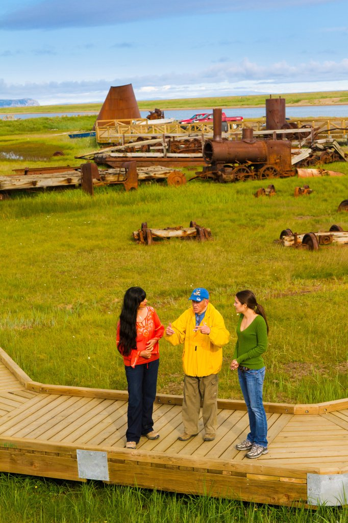 Stock Photo: 4289-13430 Tour guide gives a tour of the Last Train to Nowhere near Solomon, Nome_Council Road, Arctic Alaska, Summer