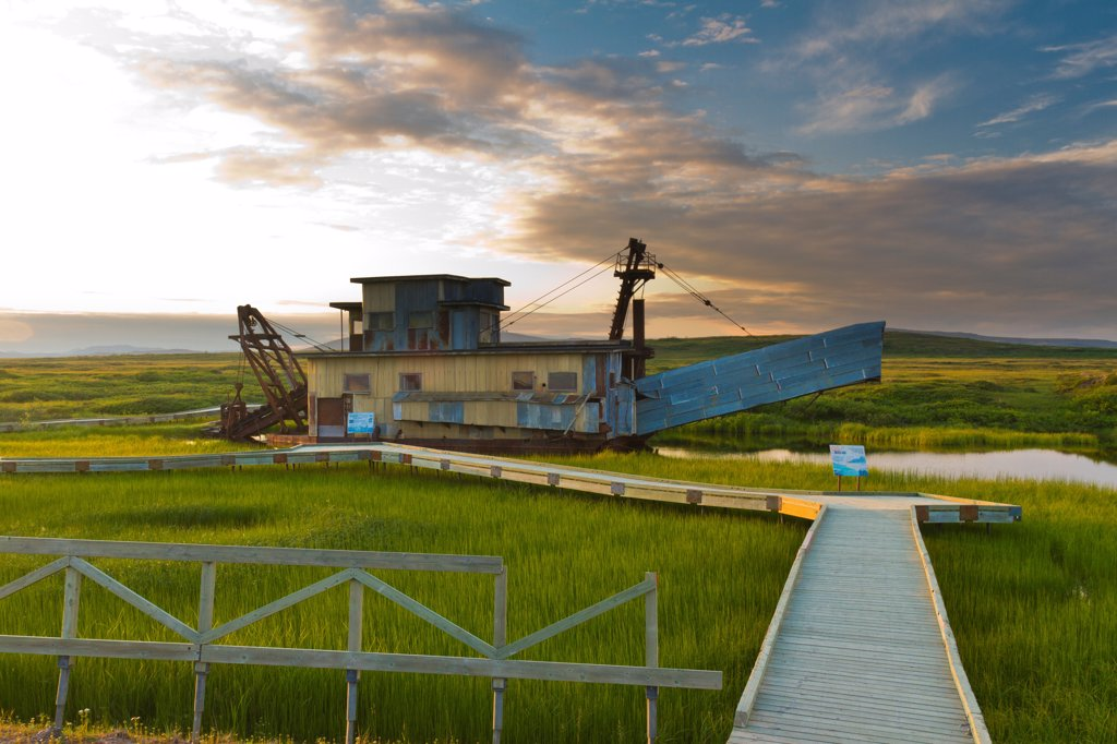 Historic Gold Dredge displayed just east of downtown along the Nome_Council Highway, Arctic Alaska, Summer : Stock Photo