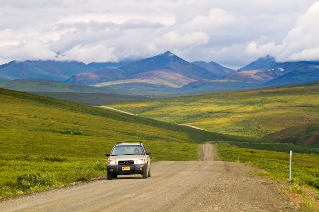 Stock Photo: 4289-13438 Vehicle driving on the Nome_Teller Highway on Alaska´s Seward Peninsula, Arctic Alaska, Summer