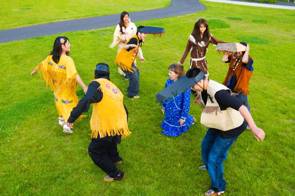 Stock Photo: 4289-13442 Athabascan dancers perform in the lawn at the Morris_Thompson Cultural Center, Fairbanks, Interior Alaska, Summer