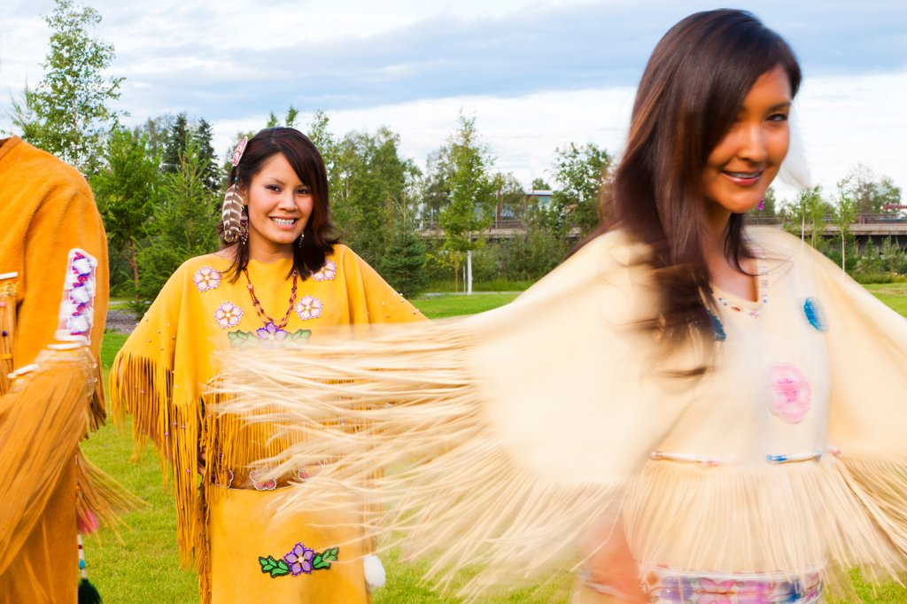 Athabascan dancers perform in the lawn at the Morris_Thompson Cultural Center, Fairbanks, Interior Alaska, Summer : Stock Photo
