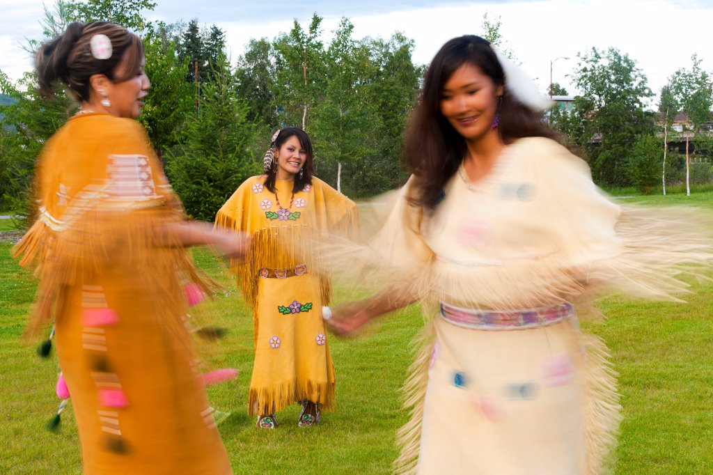 Stock Photo: 4289-13450 Athabascan dancers perform in the lawn at the Morris_Thompson Cultural Center, Fairbanks, Interior Alaska, Summer